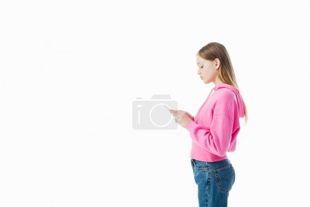 Photo for Side view of teenage girl in pink hoodie using smartphone isolated on white - Royalty Free Image