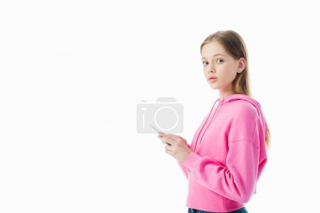 Photo for Teenage girl in pink hoodie using smartphone and looking at camera isolated on white - Royalty Free Image