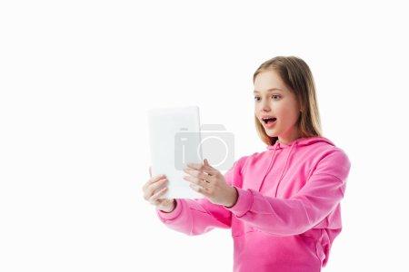 Foto de Chica adolescente excitada tener video chat en la tableta digital aislado en blanco - Imagen libre de derechos