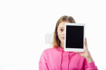 Photo for Teenage girl holding digital tablet with blank screen in front of face isolated on white - Royalty Free Image