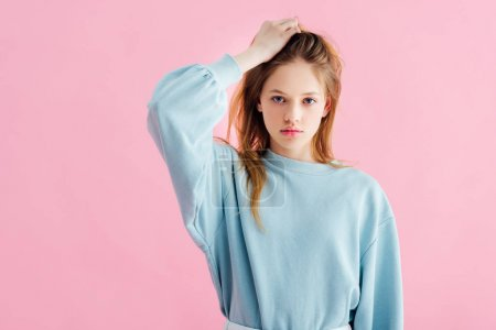 Photo for Sad pretty teenage girl touching head isolated on pink - Royalty Free Image