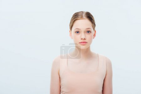 Photo for Front view of serious teenage girl isolated on grey - Royalty Free Image
