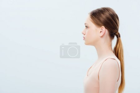 Photo for Side view of serious teenage girl isolated on grey - Royalty Free Image