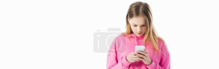 Photo for Panoramic shot of teenage girl in pink hoodie using smartphone isolated on white - Royalty Free Image