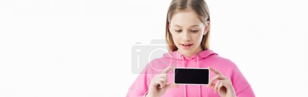 Photo for Panoramic shot of teenage girl in pink hoodie presenting smartphone with blank screen isolated on white - Royalty Free Image