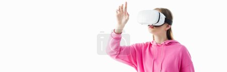 Photo for Panoramic shot of teenage girl in pink hoodie wearing vr headset isolated on white - Royalty Free Image