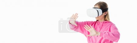 Photo for Panoramic shot of teenage girl in pink hoodie wearing vr headset and gesturing isolated on white - Royalty Free Image