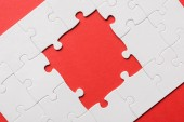 """Постер, картина, фотообои """"top view of unfinished white jigsaw puzzles isolated on red"""""""