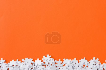 Photo for Top view of incomplete puzzle pieces isolated on orange with copy space - Royalty Free Image