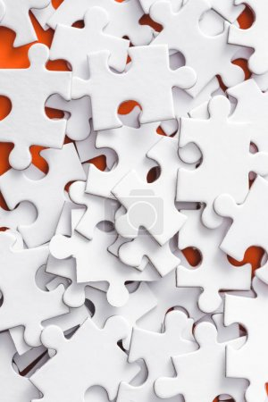 Photo for Close up of incomplete white jigsaw puzzle pieces - Royalty Free Image