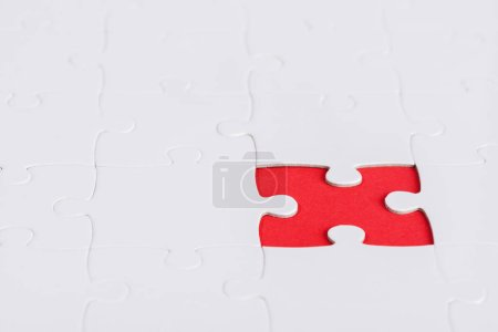 Photo for Selective focus of unfinished white jigsaw puzzle pieces - Royalty Free Image