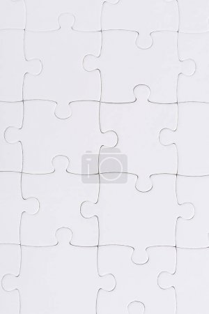Photo for Top view of set with white jigsaw puzzle pieces - Royalty Free Image