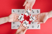 """Постер, картина, фотообои """"top view of man and woman holding white puzzle pieces with creative, idea, business and success words on white """""""