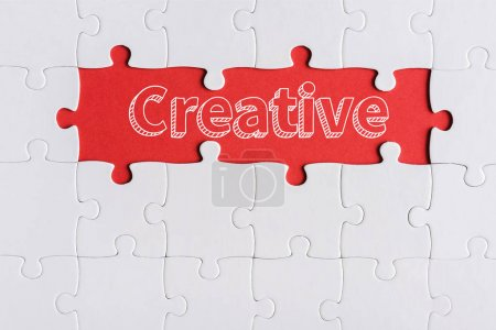 Photo for Top view of connected jigsaw puzzle pieces near creative letters - Royalty Free Image