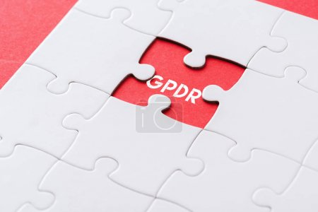 Photo for Top view of white incomplete jigsaw puzzle pieces with gpdr lettering on red - Royalty Free Image