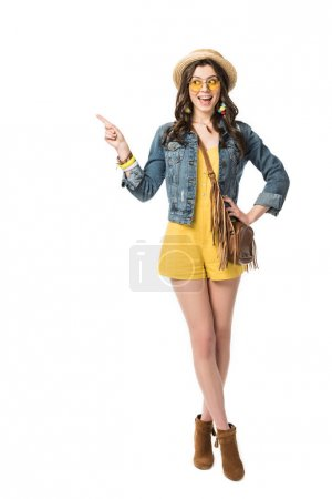 Photo for Full length view of excited boho girl in boater pointing with finger isolated on white - Royalty Free Image
