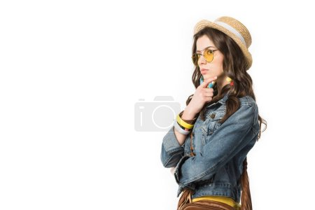 Photo for Pensive boho girl in denim jacket and straw hat looking away isolated on white - Royalty Free Image