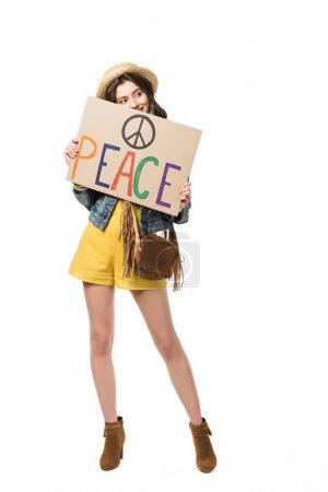 Photo pour Full length view of smiling boho girl holding placard with inscription isolated on white - image libre de droit
