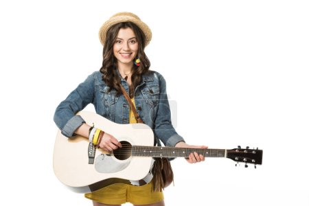 Photo for Smiling boho girl playing acoustic guitar isolated on white - Royalty Free Image