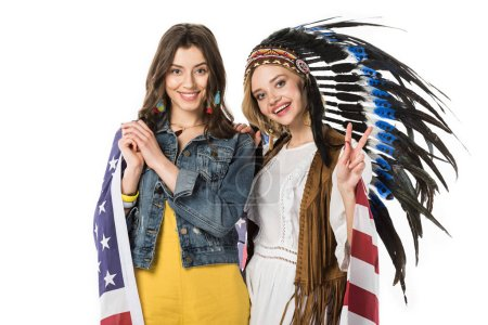 Photo pour Two bisexual hippie girls holding american flag and showing peace sign isolated on white - image libre de droit