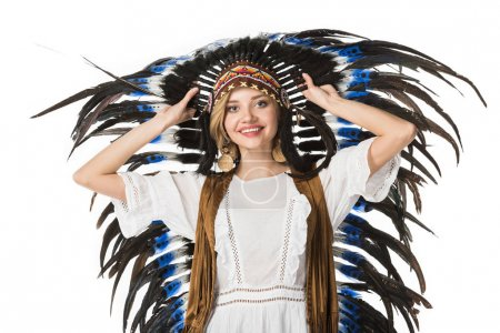 Photo for Smiling boho girl in indian headdress looking at camera isolated on white - Royalty Free Image