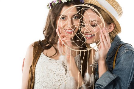 smiling bisexual couple with dreamcatcher isolated on white