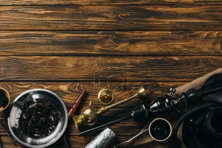 Photo for Top view of hookah, tobacco and coals on wooden surface - Royalty Free Image