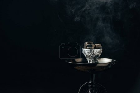 Photo for Hookah bowl with coals in smoke on black - Royalty Free Image