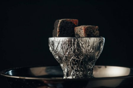 Photo for Coals on bowl and hookah isolated on black - Royalty Free Image