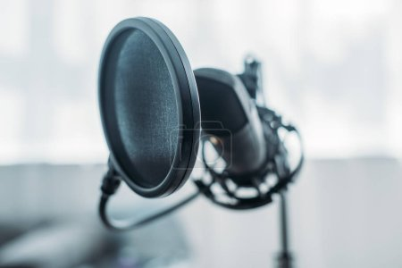 Photo for Selective focus of microphone with membrane in broadcasting studio - Royalty Free Image