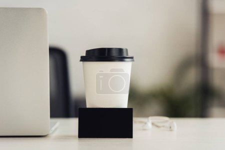 Photo for Black empty business card near paper cup and laptop on office desk - Royalty Free Image