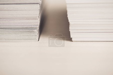 Photo for Two stacks of business cards on white surface with shadows - Royalty Free Image