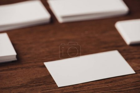 Photo for Selective focus of white blank business cards on brown wooden surface - Royalty Free Image