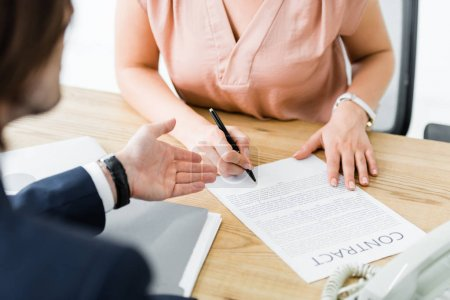 Photo for Cropped view of businesspeople signing contract in office - Royalty Free Image