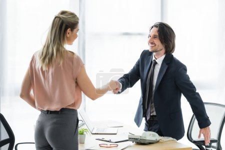 Photo for Happy businessman shaking hands with client in office - Royalty Free Image