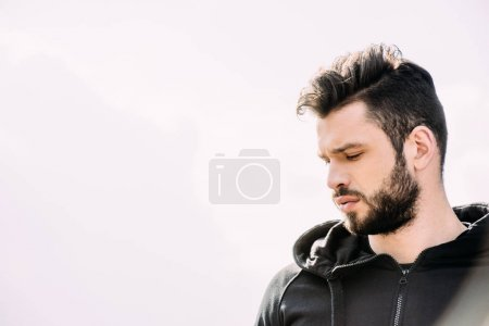 Photo for Handsome bearded man in sportswear on white with copy space - Royalty Free Image