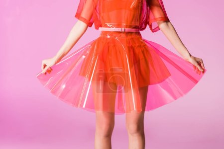 Photo for Cropped view of fashionable girl in dress on pink, doll concept - Royalty Free Image