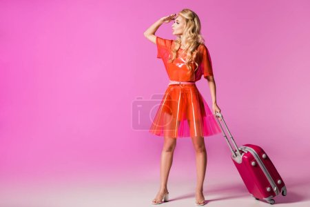 Photo for Beautiful girl with suitcase on pink and hand on head, doll concept - Royalty Free Image