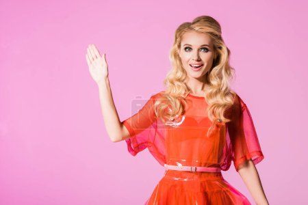 Photo for Beautiful fashionable girl waving isolated on pink, doll concept - Royalty Free Image