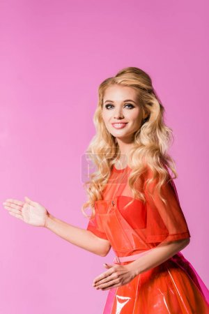 Photo for Beautiful fashionable girl posing and smiling on pink, doll concept - Royalty Free Image