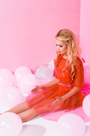 Photo for Beautiful girl posing near balloons on pink, doll concept - Royalty Free Image