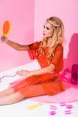 """Постер, картина, фотообои """"beautiful girl sitting with hand mirror on pink, doll concept"""""""