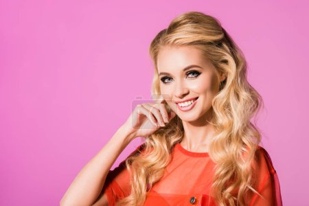Photo for Beautiful smiling fashionable girl isolated on pink, doll concept - Royalty Free Image