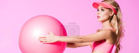 Photo for Panoramic shot of girl in sportswear with Fitness Ball isolated on pink, doll concept - Royalty Free Image