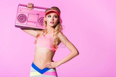 Photo for Beautiful girl in sportswear with boombox isolated on pink, doll concept - Royalty Free Image