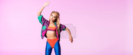 Photo for Panoramic shot of beautiful girl in sportswear gesturing isolated on pink, doll concept - Royalty Free Image