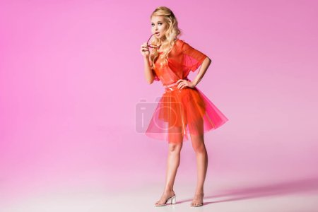Photo for Beautiful fashionable girl with sunglasses on pink, doll concept - Royalty Free Image