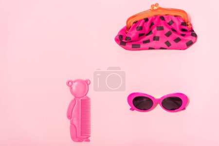 Photo for Top view of organized accessories isolated on pink - Royalty Free Image