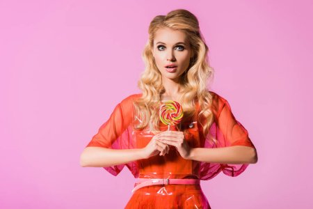 Photo for Beautiful girl posing with lollipop isolated on pink, doll concept - Royalty Free Image