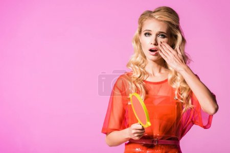 Photo for Beautiful girl with hand mirror yawning isolated on pink, doll concept - Royalty Free Image
